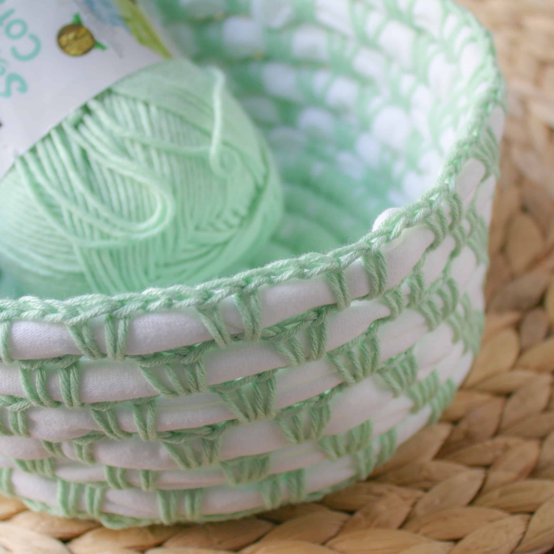 Use this free crochet pattern and photo tutorial to epicycle old material into usable baskets.