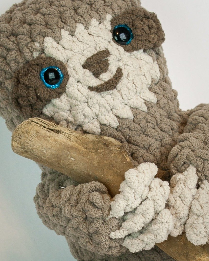 One skein of yarn and you can have this adorable plush sloth! He is easy to create using only the basic stitches. He is quick and great for beginners. This is a wonderful free crochet pattern. #crochet #pattern #free #amigurumi