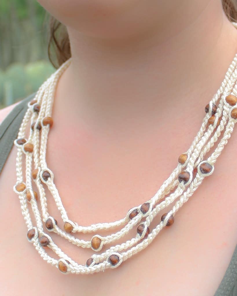 Use this free crochet pattern and in less than 30 minutes you will have a new crochet bohemian style beaded necklace. This is a great pattern that is quick and easy and great for beginners. #crochet #free #pattern #freepattern #crochetnecklace #quick #easy #forbeginners