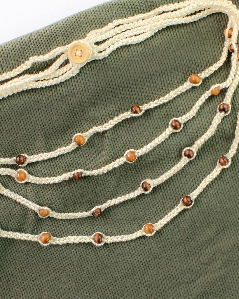 Use this free crochet pattern and in less than 30 minutes you will have a new bohemian style beaded crochet necklace. This is a great pattern that is quick and easy and great for beginners. #crochet #free #pattern #freepattern #crochetnecklace #quick #easy #forbeginners