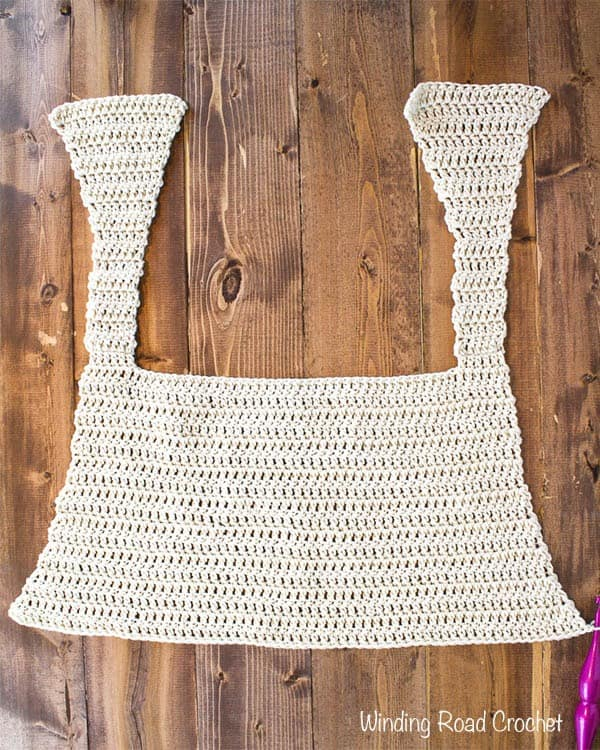 The Goldenrod summer crochet tank top is a fun free crochet pattern that is designed to flatter most body types. The top is made with mostly double crochet. This crochet top is loose fitting and nice and airy. #crochet #freepattern #pattern #free #crochet #crochetsummertop #summertop #summer #tanktop