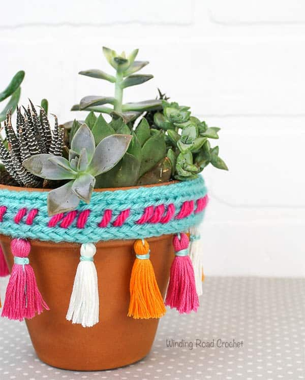 Tassels are so popular right now. They are being used on earrings, blankets, pillows, scarves and so much more. I developed an easy method to make mini tassels to hang from the rim of terra cotta pot. I also include a quick crochet project to use the tassels on. #tassels #embroideryfloss #crochetpattern #tutorial