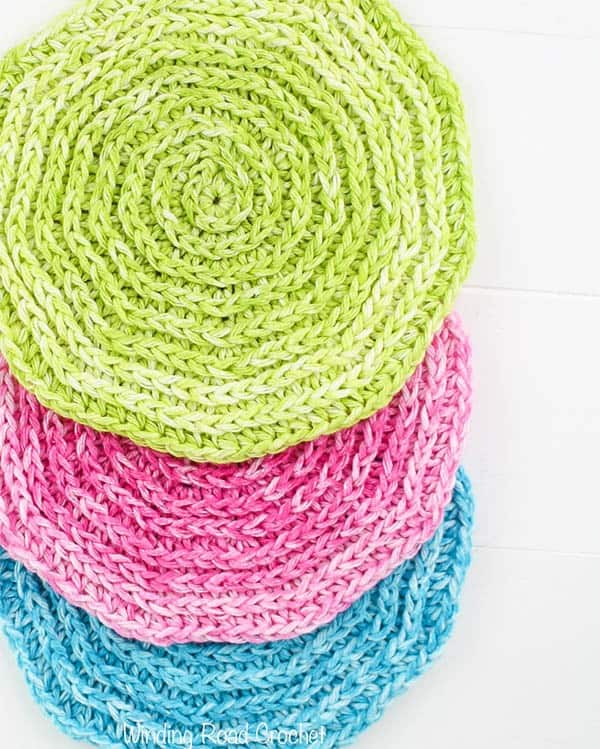 The Seeing Spirals washcloth free crochet pattern is quick, easy and great for beginners. This project works up fast makes a unique spa like washcloth. This is a small project that would make a great gift. #crochet #freepattern #quick #easy #forbeginners #crochetpattern #crochetwashcloth #unique #spa