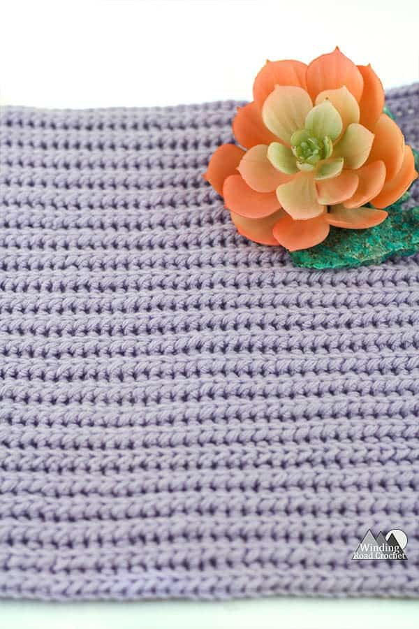 Learn to crochet a beautiful ribbing texture using the crochet yarn over slip stitch ribbing. #crochetstitch #crochettutorial