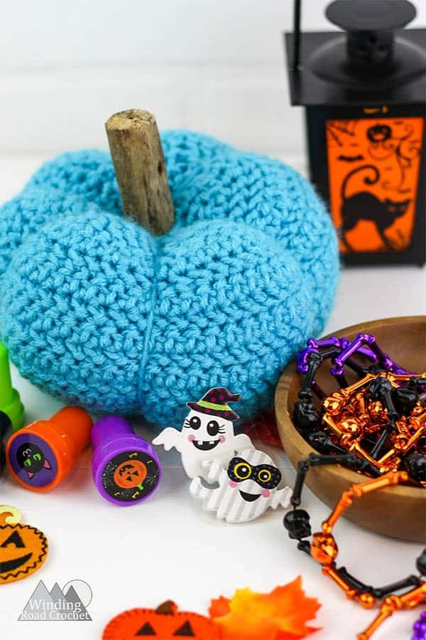 Pretty Little Crochet Pumpkin Free Pattern | This little pumpkin is great for your fall decorations. This crochet pumpkin has a unique texture and is a fun quick project. #pumpkin #crochet #crochetpumpkin #fallcrochet
