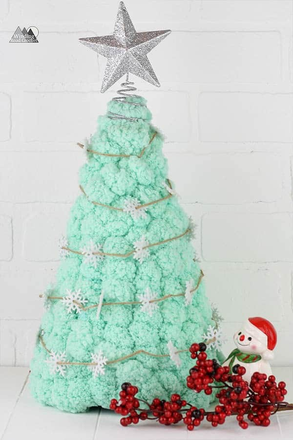 Make a Pompadoodle tree quick and easy. Have your kids help you decorate. This is a fun quick and easy crochet christmas project.
