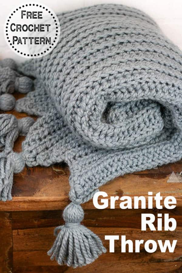 Crochet this beautiful thick crochet blanket. This free crochet pattern for the granite rib throw works up quickly. Learn how to make tassels and how to make this faux knit ribbing blanket with the video tutorial. #crochetblanket #ribblanket #crochetthrow #crochetafghan