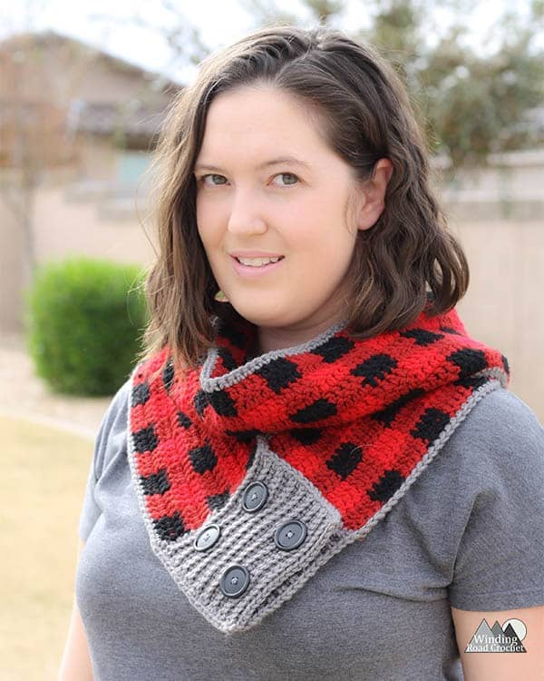 Make a fun plaid convertible crochet scarf that can be worn as an infinity scarf or as a long scarf. This pattern is great fro beginners that have a good grasp of the basic stitches. This scarf works up rather quickly and makes a great gift. Get the free crochet pattern. #freecrochetpattern #plaidcrochet #crochetplaid #crochetscarf #crochetinfinityscarf