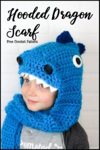 Crochet this easy and detail filled Hooded Dragon scarf. It is complete with claws, spikes, nostrils, eyes and teeth. This free crochet pattern uses only basic stitches and works up quick and easy. It is a great pattern for beginners that uses clever sewing methods to create a lot of fun details. #crochet #dragoncrochet #crochetdragon