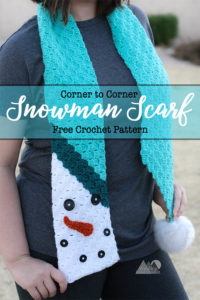 C2C Snowman Scarf is a beautiful fun and creative way to create a fun scarf using the corner to corner crochet technique. Follow this free crochet pattern to create a whimsical crochet scarf. with a snowman motif. #crochetscarf #crochetpattern