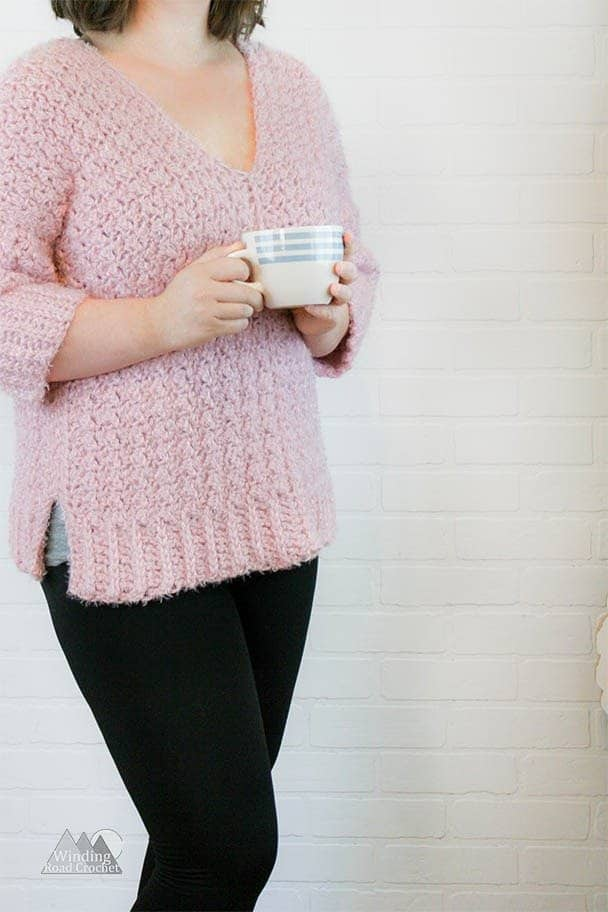 Learn how to crochet this unique oversized texture v-neck crochet sweater. This sweater is made by crocheting four simple rectangles and sewing them together. By alternate different stitches we are able to make a rib looking edge. This is a beautiful women chunky crochet sweater. Enjoy the free crochet pattern. Sizes X-Small through XX-large.