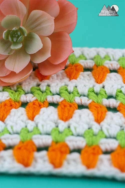 Learn to make the garden inspired carrot crochet stitch with this video tutorial. This is a great stitch to add some spring detail to any crochet project.