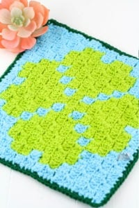 Crochet a quick Corner to corner crochet wash cloth or pot holder using this small Four Leaf Clover C2C graph. This graph works up quickly and is designed to c2c beginners. Get the graph, written chart and suggestions for using yarn bobbins. #c2ccrochet #crochetwashcloth #crochetpotholder
