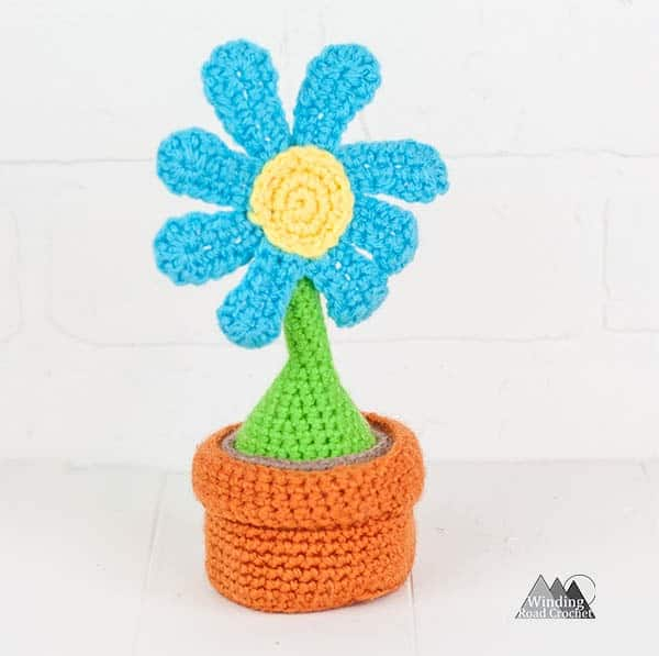 Crochet baby toy, the amigurumi container garden. This crochet toy is great for kids and babies. If uses easy amigurumi techniques to complete this free crochet pattern. #