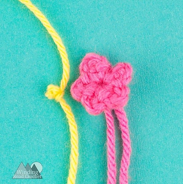 Crochet a cute amigurumi gnome with this free crochet pattern. The garden gnome is a perfect spring project and works up quick. Using only basic stitches this garden gnome is an easy project. Crochet one to watch over your garden. #crochetgnome #amigurumicrochet #springcrochet