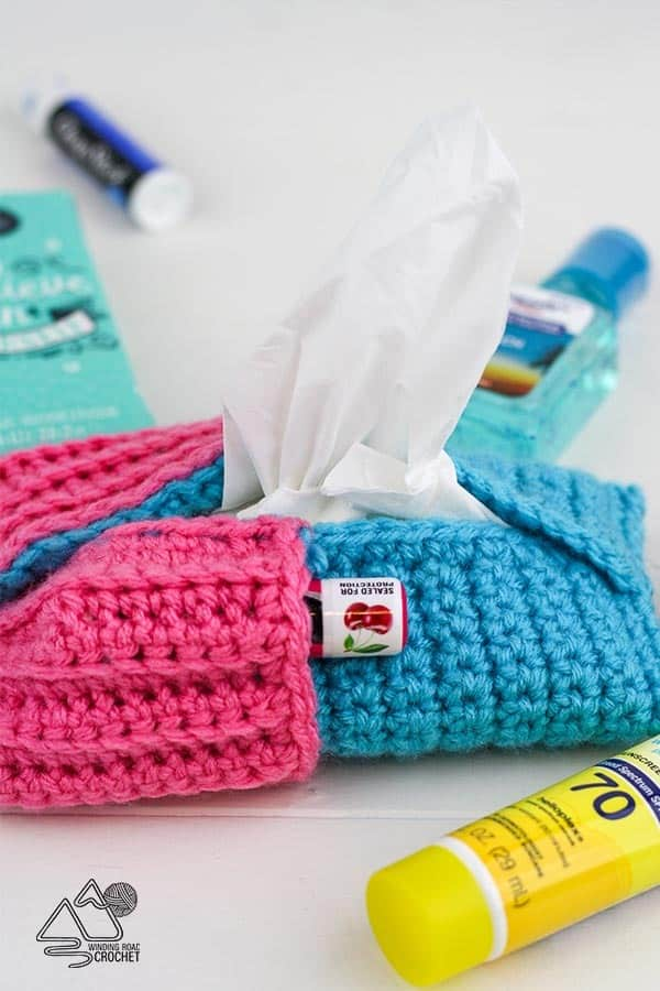 Make a quick and easy crochet tissue pouch with pocket. This free pattern for beginners make a perfect pouch for purses, bags, backpacks and more. #crochetpouch #crochetpattern