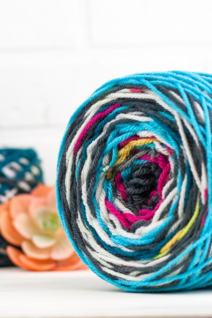 Make a cute boho style bag from your yarn scraps. This Crochet Scraps bag is beginner friendly and I will even show you how I completed it without sewing. #crochetbag #crochettote #scrapyarn