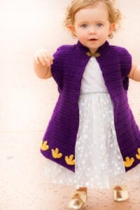 Don't let your girl's be a frozen princess on Halloween. Keep them her warm with this Crochet Cape Coat. Free crochet pattern by Winding Road Crochet.