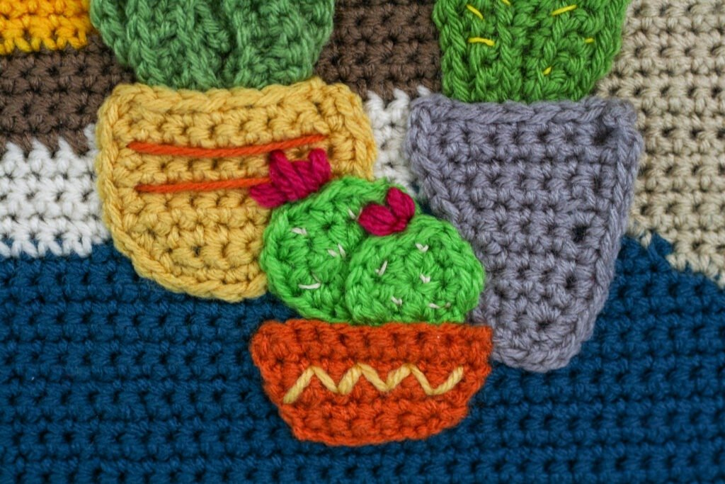 Learn to crochet a single crochet applique with this video tutorial. Plus patterns for finishing the Crochet Painting Crochet a Long.