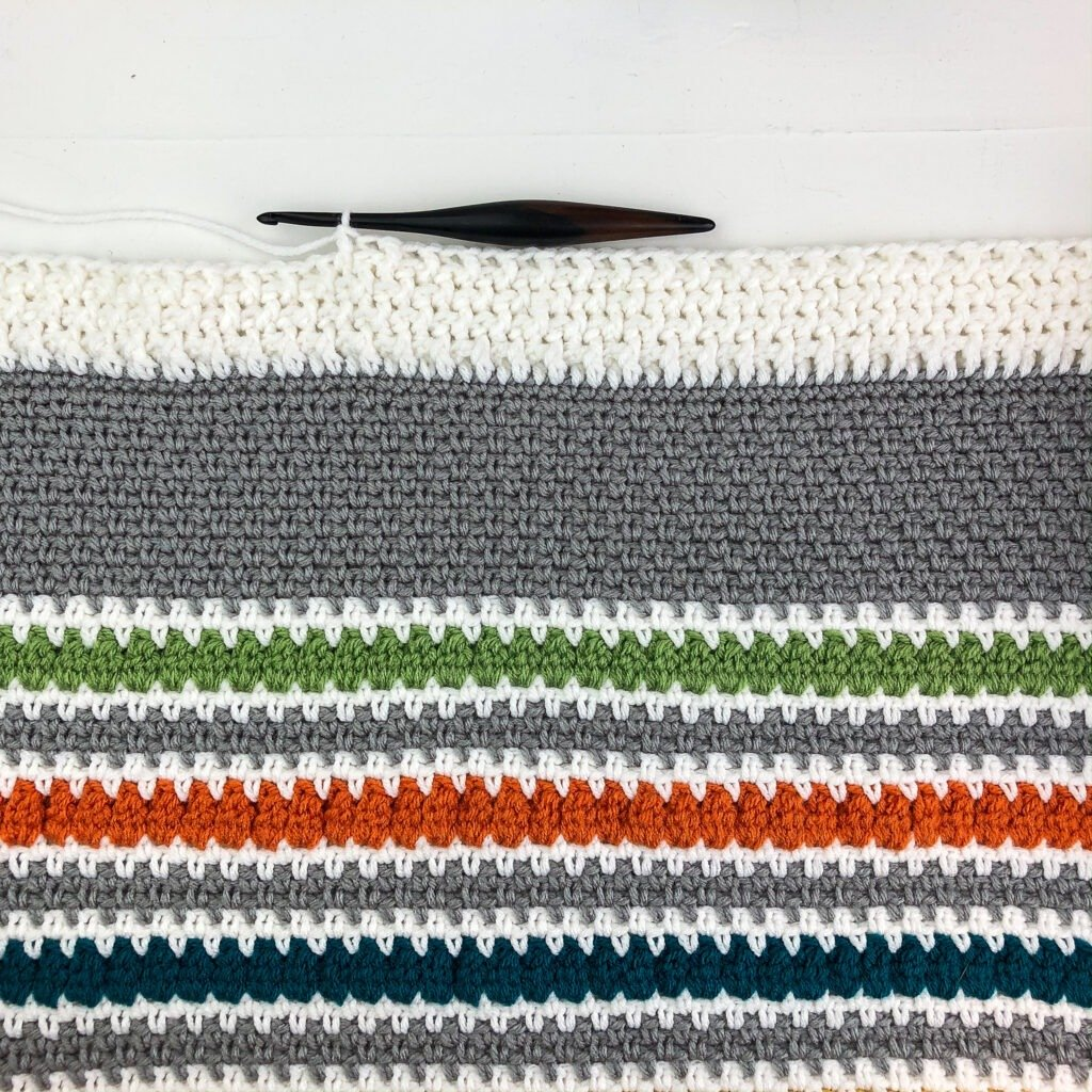 This crochet blanket border has a beautiful textured stitch. Follow this video tutorial or written pattern to learn how to make this border.