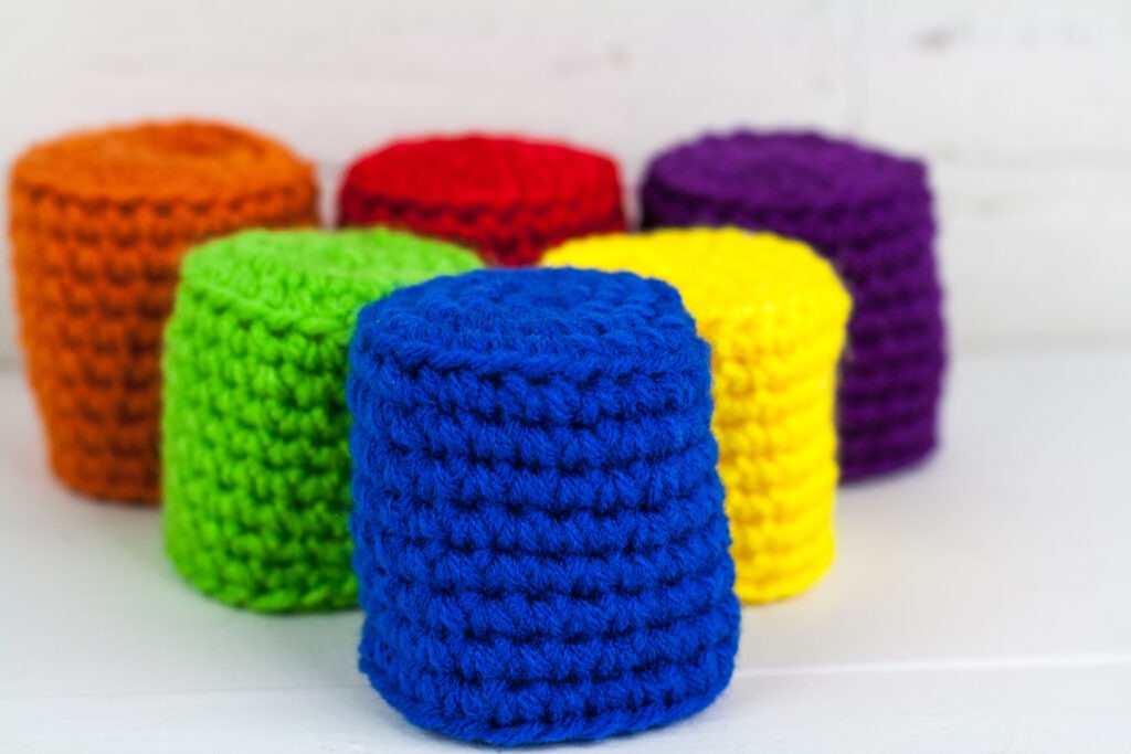 A quick crochet toy can keep the kids busy for hours. Use the free crochet pattern to make a minimalist bowling game for the kids.