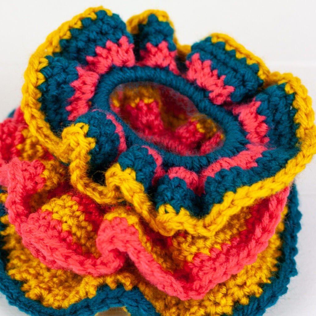 You can make these beginner-friendly crochet scrunchies in about ten minutes. Quick, easy and free crochet pattern with video tutorial.