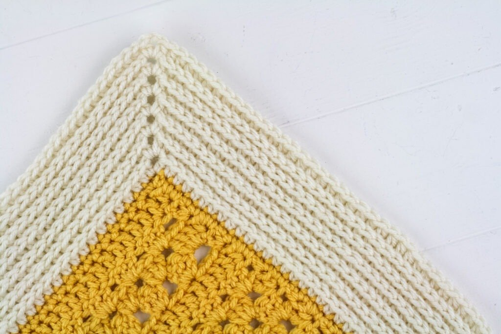 Learn to crochet the bobble stitch witht this video and photo tutorial and then use it to make a quick and easy soap mat pattern.