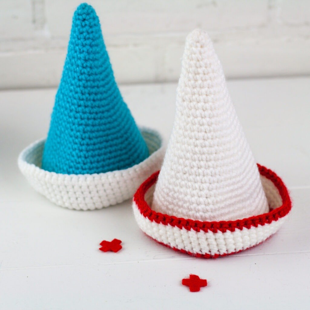 A crochet gnome pattern to honor our everyday heroes. Crochet a doctor and nurse gnome with this free crochet pattern by Winding Road Crochet.