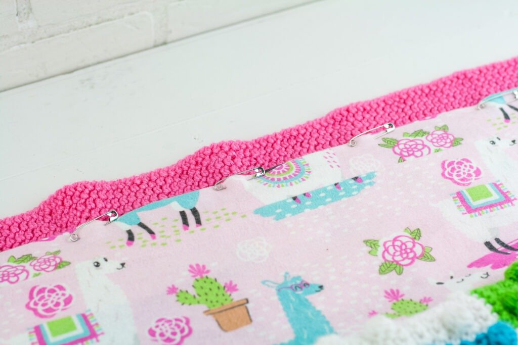Learn to line a crochet blanket with fabric. This written and video tutorial will show you how to sew a liner in by hand or sewing machine.