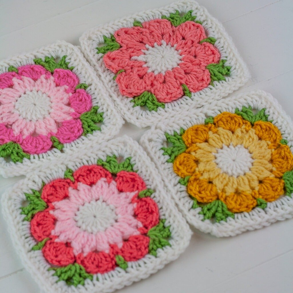 This free crochet pattern for a crochet flower granny square looks wonderful worked as a single color flower or a two toned flower. Video tutorial.