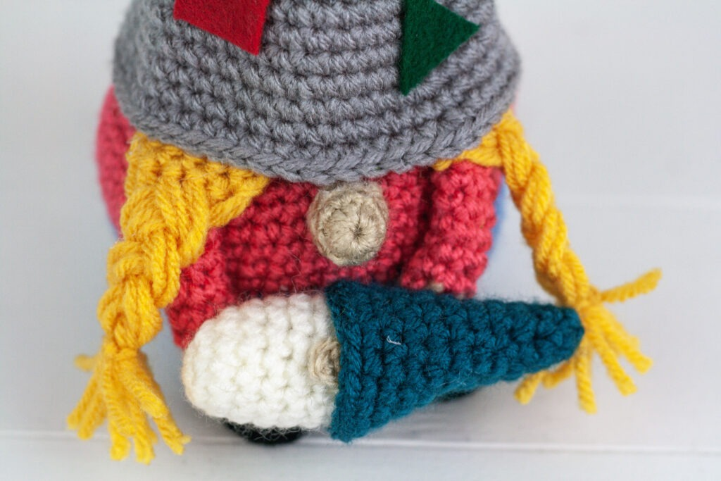 Crochet a daycare gnome or mommy and a baby gnome with this free crochet pattern. This gnome makes a great gift or just add them to your collection.
