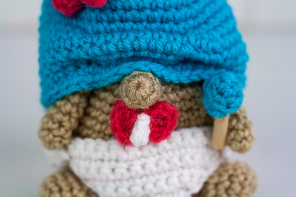 Crochet a baby gnome with this free crochet pattern. This gnome will make a wonderful gift for a baby shower or expecting mother.