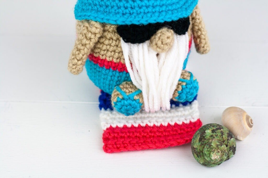 Crochet a summer vacation gnome with this free crochet pattern. This gnome likes to sit on the beach and soak up the sun. Enjoy the summer with him.