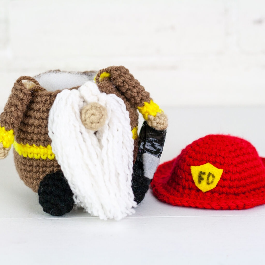 Crochet a firefighter gnome with this free crochet pattern. This is one of many of my profession gnomes series. This gnome makes a perfect gift.