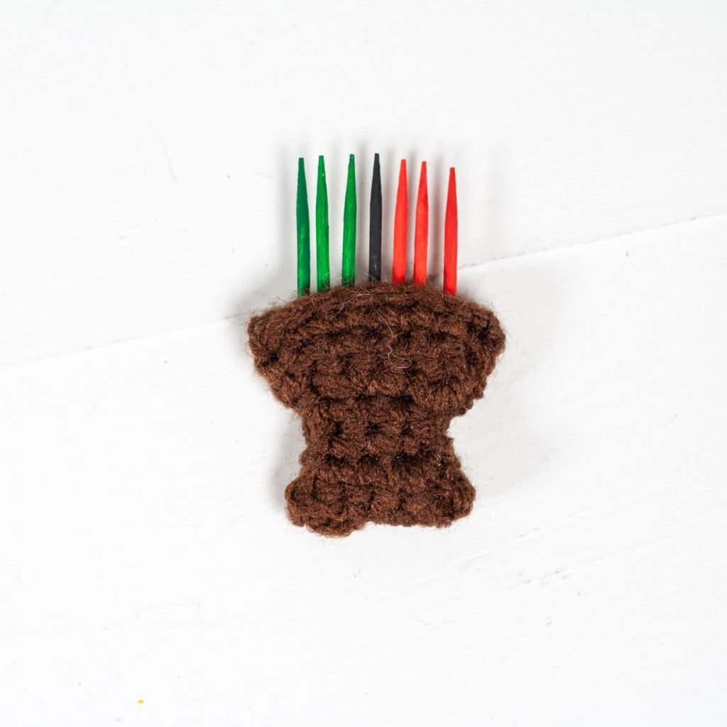 Celebrate the holidays with this crochet Kwanzaa gnome. Free crochet pattern for a fun holiday decoration with video tutorials.