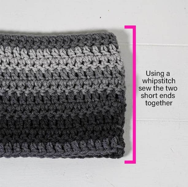 This free crochet pattern is perfect for beginners. This crochet ombre scarf pattern is easy to follow and makes a perfect quick and easy gift.