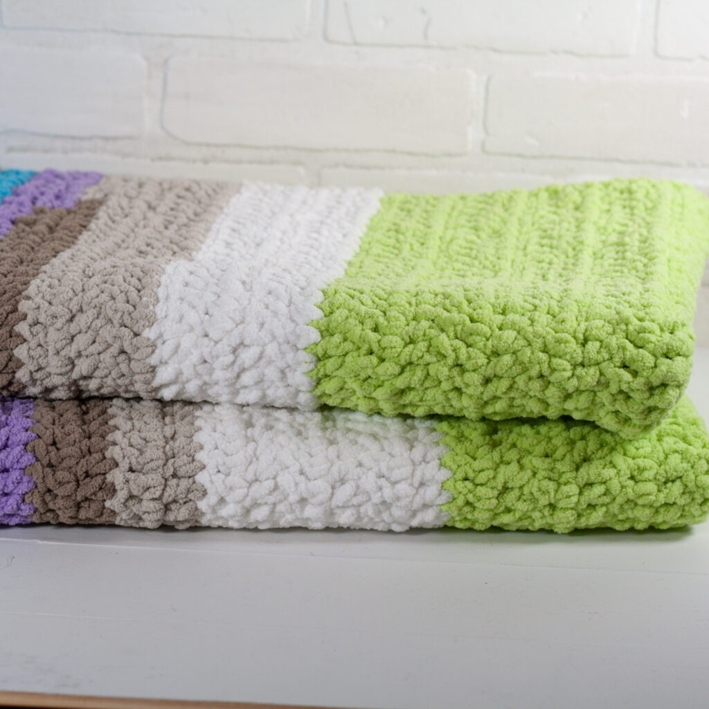 This free crochet pattern is perfect for beginners. You will want to snuggle up all winter in this beginner crochet blanket.