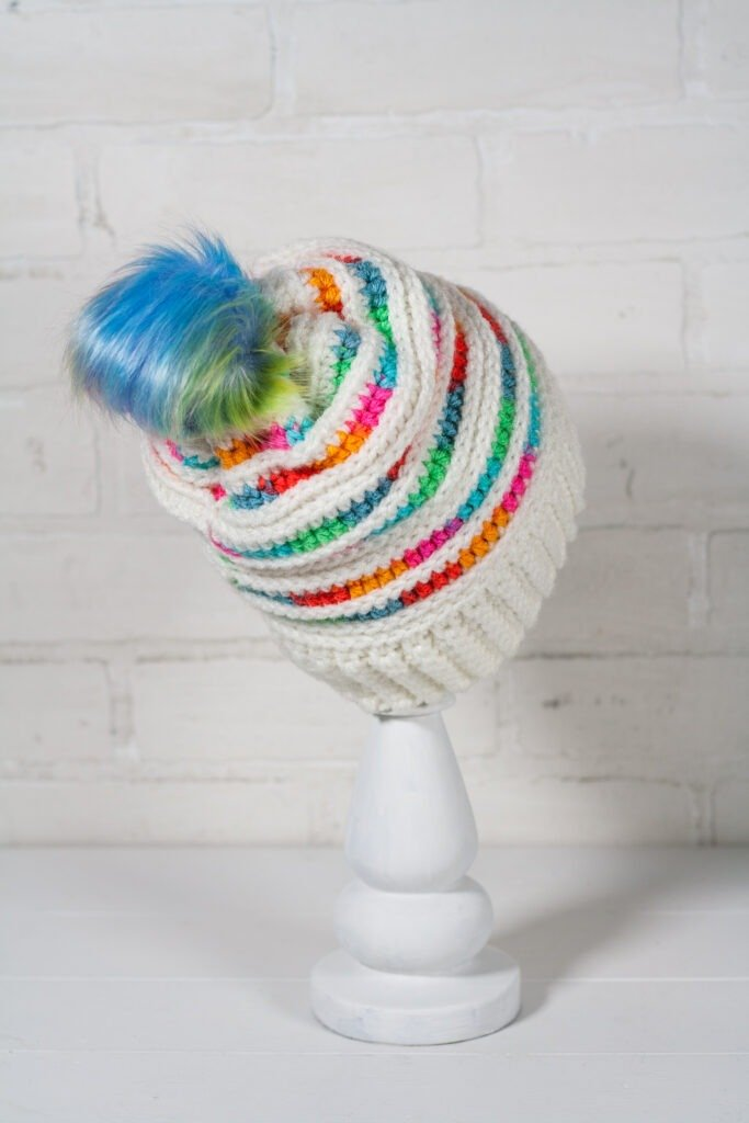 You will love the prismatic crochet beanie pattern and its balance of color. It works up quickly and has a helpful video tutorial.
