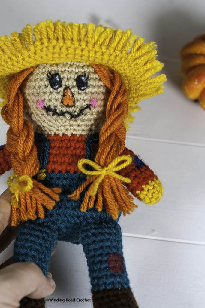 You will love making this adorable, easy crochet scarecrow. You will use basic amigurumi techniques and learn a new way to add a cute face.