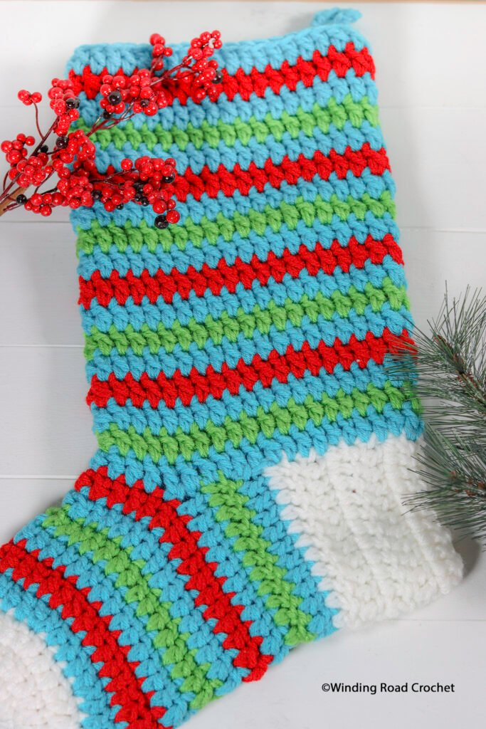 One Hour stocking free crochet pattern and video tutorial. You will be so surprised how fast you can crochet a Christmas stocking.