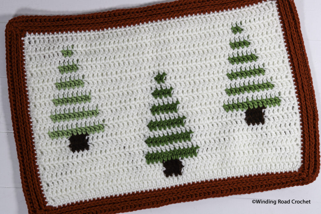 Make a modern ombre crochet table runner and matching placemats. Free crochet pattern with helpful video tutorials. Perfect for all winter.