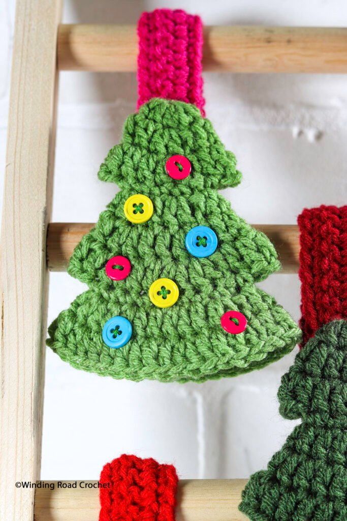 You will love this Christmas tree crochet towel topper. Whip up one as a little holiday gift. Free crochet pattern with instructional photos.