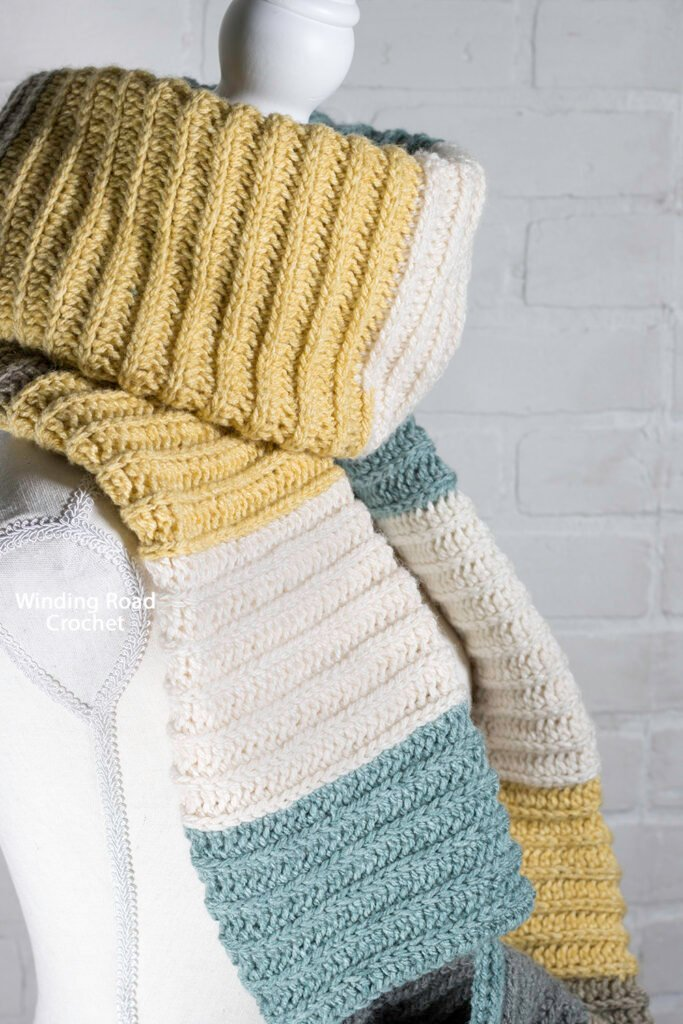 This easy crochet pocket infinity scarf is a clever way to combine the two popular scarf styles into one. Free pattern and video tutorial.