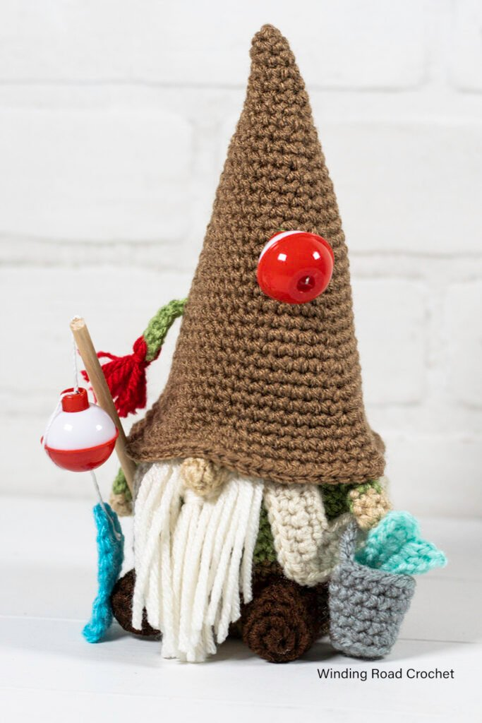 A crochet fishing gnome makes a great gift Father's day gift for a fisherman. This free crochet pattern will help you make an adorable gnome.