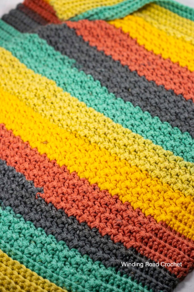 You will love this easy crochet baby blanket pattern. It works up quickly and is beginner friendly. Free crochet pattern with video tutorial.