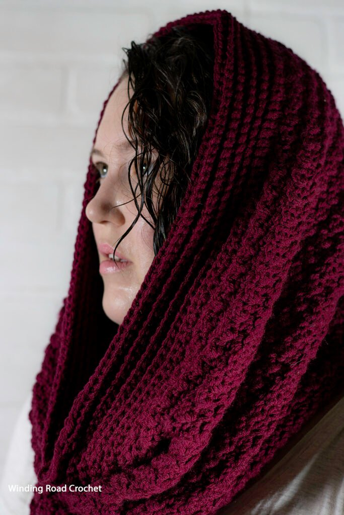 This textured crochet cowl is large looks like an infinity scarf and tall enough to be a hood. Enjoy the free crochet pattern and video.