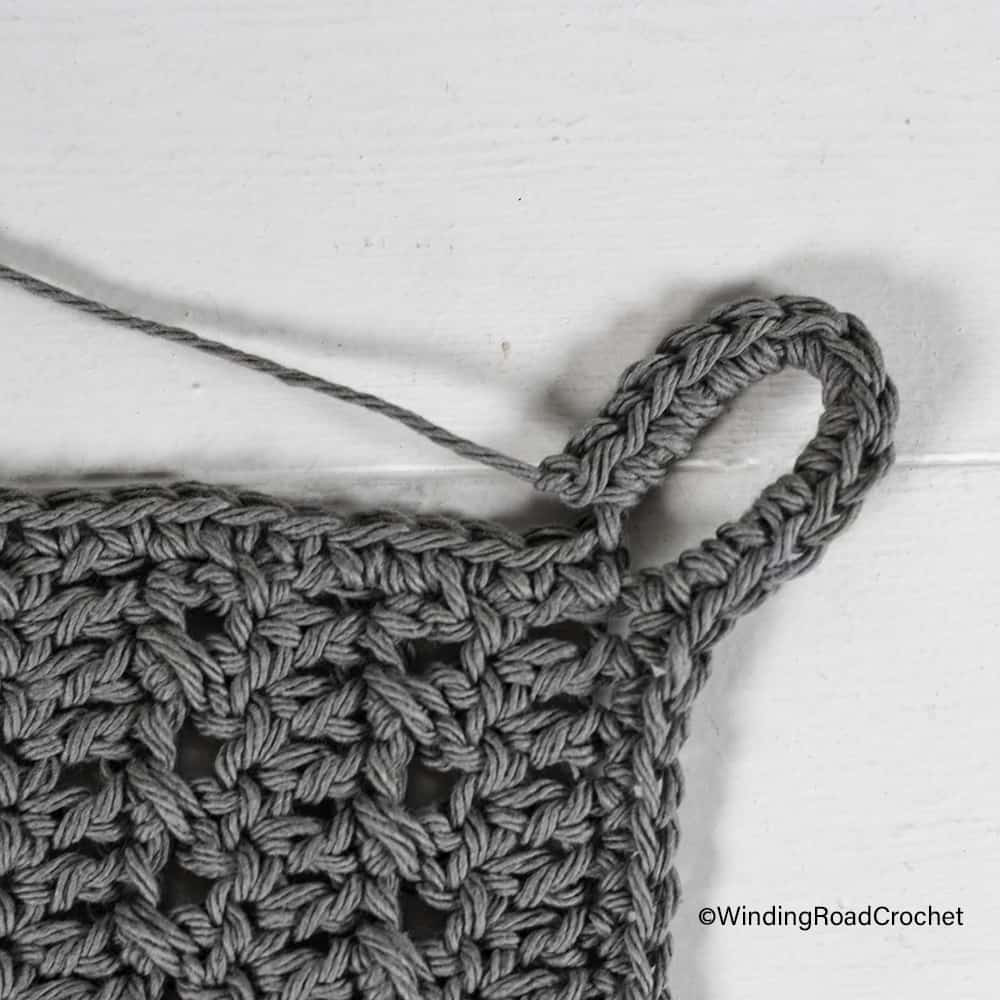 You will love making this quick and easy crochet hanging wall basket. It is made from a simple square and very easy to crochet.