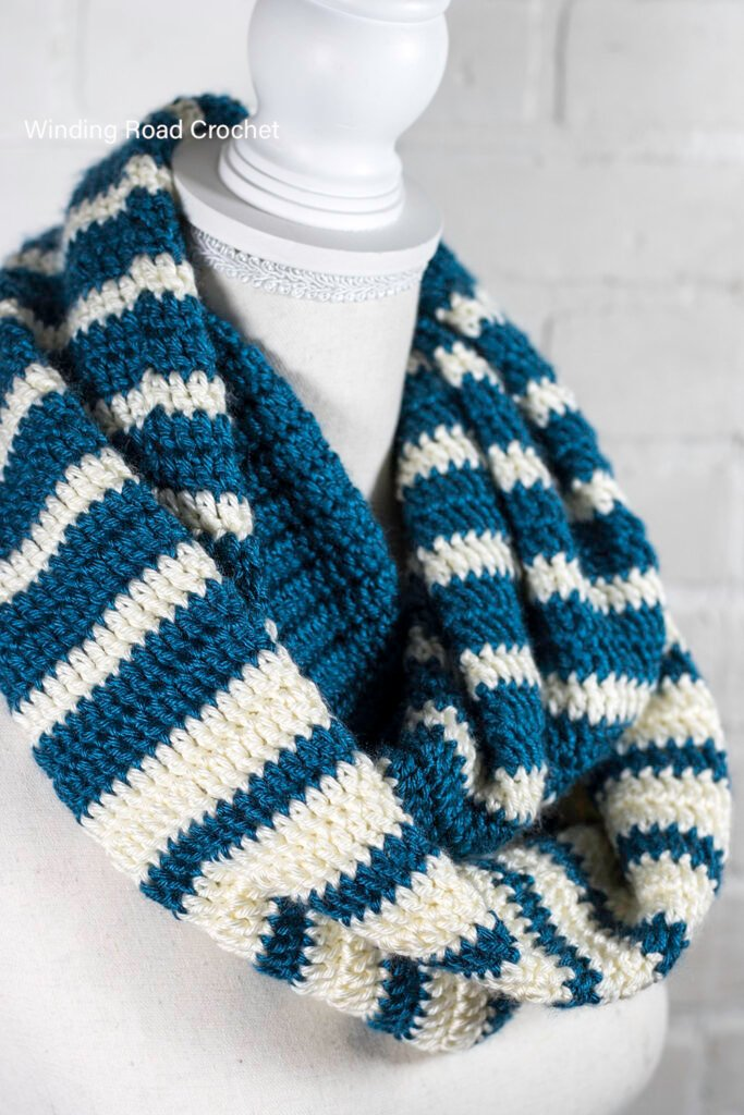 This is an easy striped crochet scarf pattern with a beautiful reverse striped design. Free crochet pattern for an unique infinity scarf.