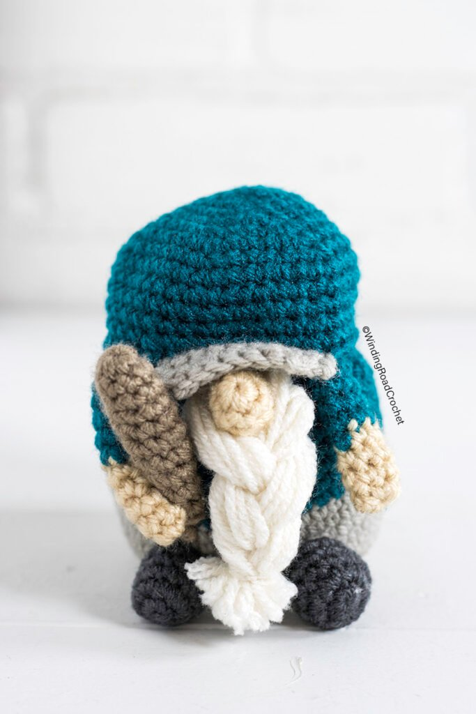 A crochet baseball gnome makes a great Father's day gift for a sports fan. Free crochet pattern for a cute gnome with helpful videos.