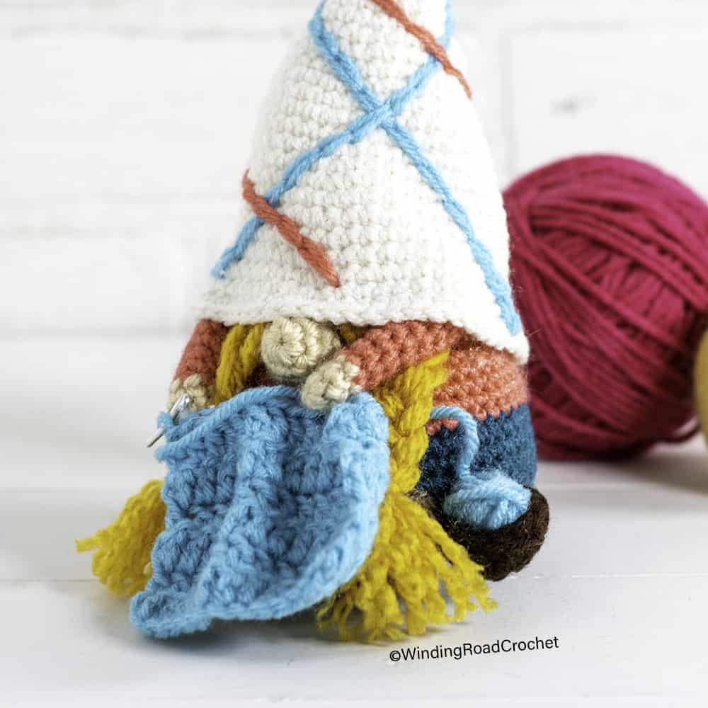 This crocheting gnome will keep you company while you crochet. Free crochet pattern for a cute gnome with helpful videos.